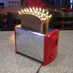 The Daghoffer, toaster art by John Baron. Up cycle toaster has nightlights as kitchen artwork in red enamel.